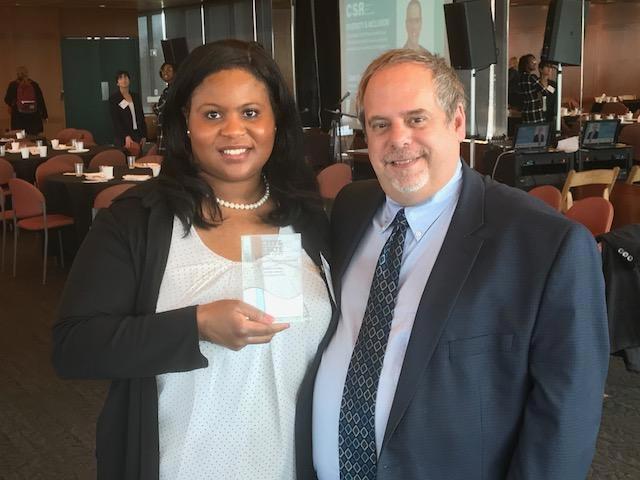 Mishka Woodley receiving award